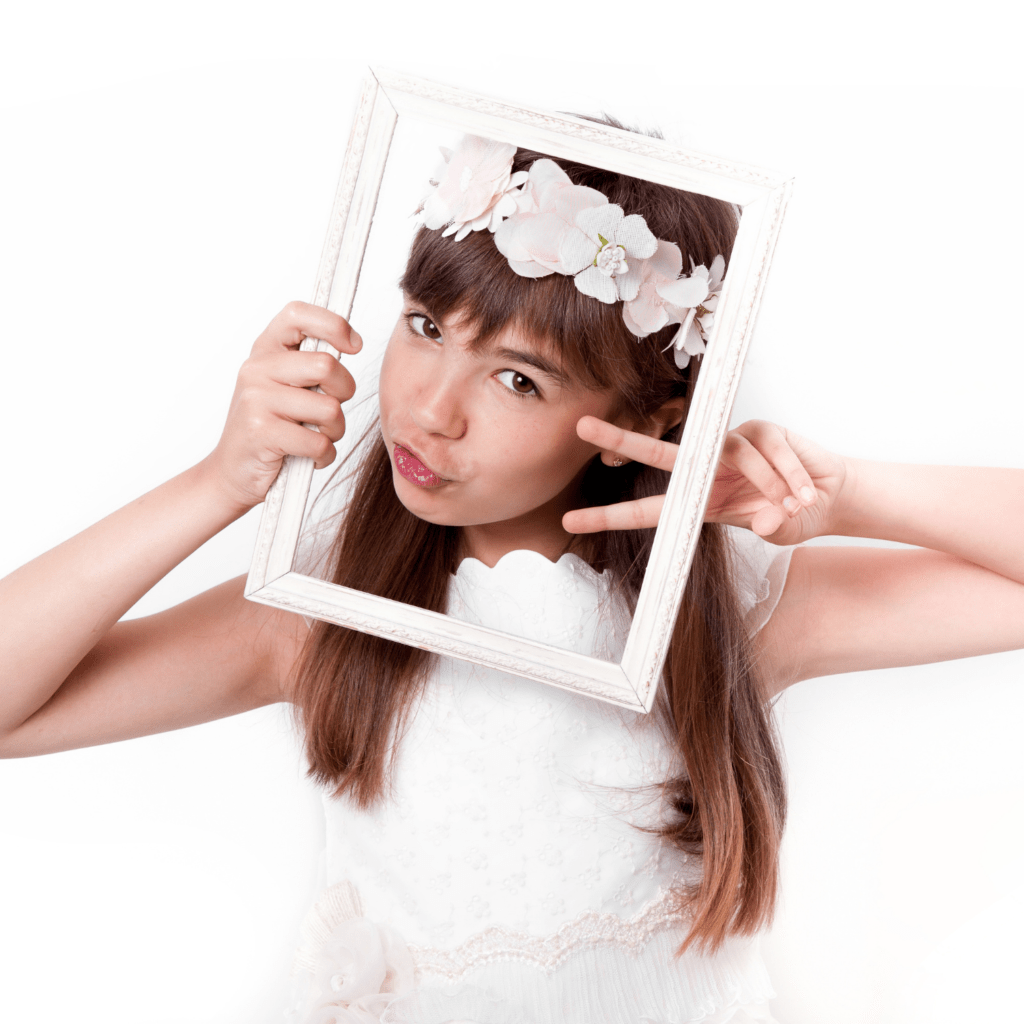 communion-girl-grimacing-with-frame-on-her-face